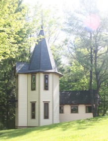 Photo of the Tower Apartment with its slate-clad cathedral ceiling and wrought-iron veranda.