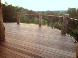 photo-hilltop-suite-surround-deck-with-custom-wrought-iron-railing-amazing-sunset-view